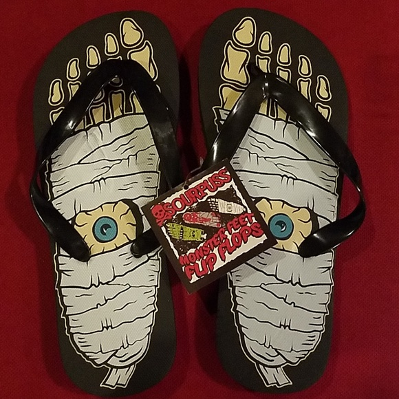 dc4a14fea7888 Sourpuss Mummy Eyeball Halloween Flip Flops Shoes
